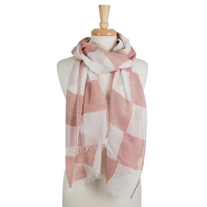 "White open scarf featuring a red gingham print and frayed edges. 40% cotton and 60% polyester. Approximately 28"" x 78"" in size."