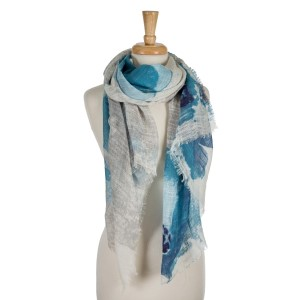 "Navy blue, royal blue, and gray floral print scarf with frayed edges. 100% cotton. Measures approximately 36"" x 72."""