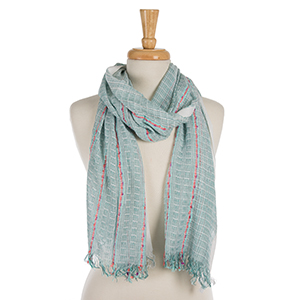 "Beige and mint green scarf with coral accents and frayed edges. 100% viscose. Measures approximately 20"" x 72."""