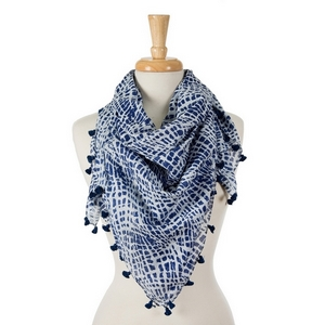 "Navy blue and white tie-dye print square scarf with pom poms along the edges. 100% cotton. Measures approximately 42"" x 42"" in size."