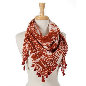 "Marsala and white tie-dye damask print square scarf with pom poms along the edges. 100% cotton. Measures approximately 42"" x 42"" in size."
