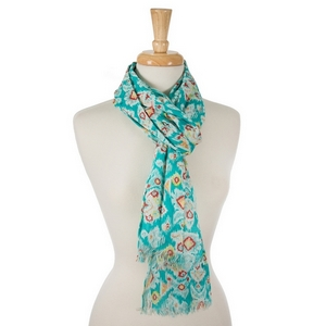 "Mint green open scarf featuring a white, coral and yellow Ikat pattern. 100% cotton. Measures approximately 28"" x 72"" in size."