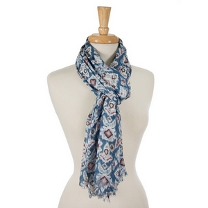 "Navy blue open scarf featuring a white, light blue and purple Ikat pattern. 100% cotton. Measures approximately 28"" x 72"" in size."