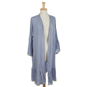 Powder blue open cardigan featuring 3/4 length bell sleeves  and lace detailing on the outer edges. 100% cotton. One size fits most.