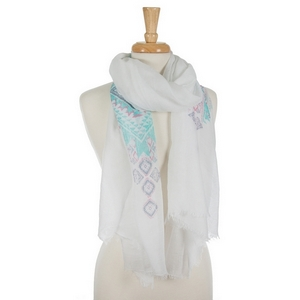 "Lightweight white scarf featuring a mint green tribal print and frayed edges. 35% viscose and 65% polyester. Measures approximately 78"" x 36"" in size."
