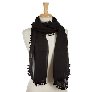 "Black open scarf with pom poms on the edges. 35% viscose and 65% polyester. Measures approximately 72"" x 28"" in size."