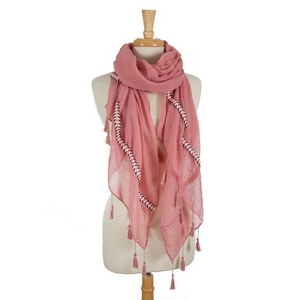 "Pink open scarf featuring embroidered details on the ends and tassels on the edges. 35% viscose and 65% polyester. Measures approximately 72"" x 32"" in size."