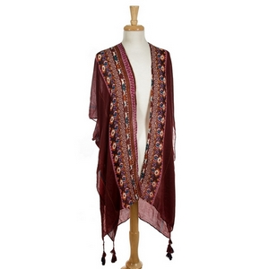 Burgundy, short sleeve kimono featuring a tribal print. 60% cotton, 30% acrylic, and 10% polyester. One size fits most.