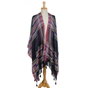 Navy blue draped kimono featuring a neon  plaid print and tassels on the edges. 100% viscose. One size fits most.
