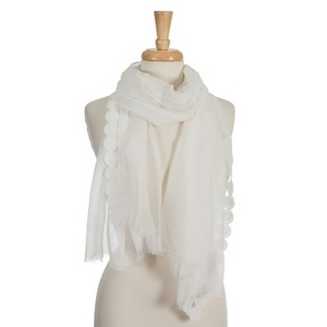 "White open scarf with a circle crocheted trim along the outer edge. 70% polyester and 30% cotton. Measures approximately 29"" x 72"" in size."