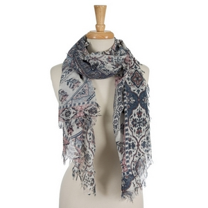 "White open scarf featuring a navy blue and coral floral and paisley pattern. 70% polyester and 30% cotton. Measures approximately 34"" x 72"" in size."