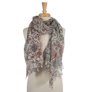 "White open scarf featuring a mint green and coral floral and paisley pattern. 70% polyester and 30% cotton. Measures approximately 34"" x 72"" in size."