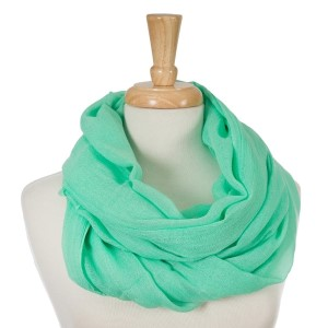 """Mint green, lightweight infinity scarf. 100% cotton. Approximately 35"""" x 42"""" in size."""