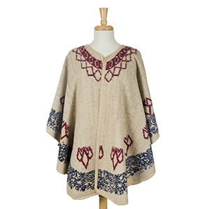 Beige cape with a navy blue pattern. 100% acrylic. One size fits most.