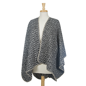Black and white cape with a tweed print and beige stitching. 100% acrylic. One size fits most.