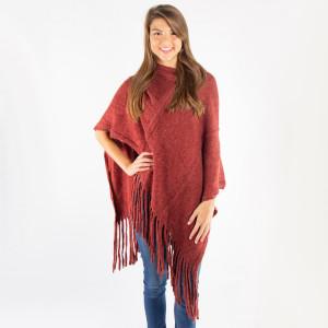 Burgundy knit poncho with tassel twist trim. 100% acrylic. One size fits most.
