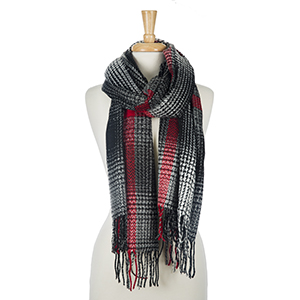 """Black, red and white printed, open scarf with tassels on the ends. 100% acrylic. Measures 28"""" x 80"""" in size."""