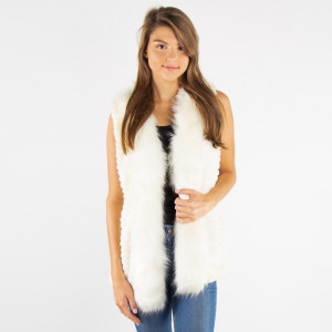 Ivory faux fur vest with an open front. 100% polyester. One size, fits up to a standard large.