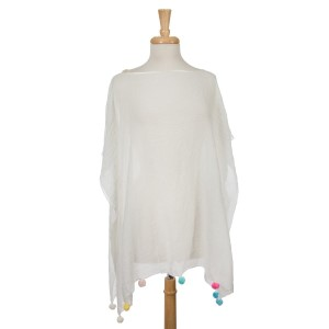White short sleeve poncho with multicolored pom poms on the bottom hem. 30% cotton and 70% polyester. One size fits most.
