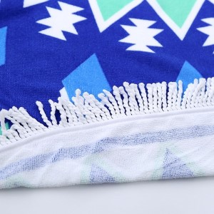 """Blue starburst printed terry cloth roundie beach towel with frayed edges. 100% cotton. Approximately 60"""" in diameter."""