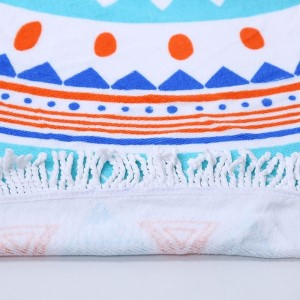 """Turquoise and orange printed terry cloth roundie beach towel with frayed edges. 100% cotton. Approximately 60"""" in diameter."""