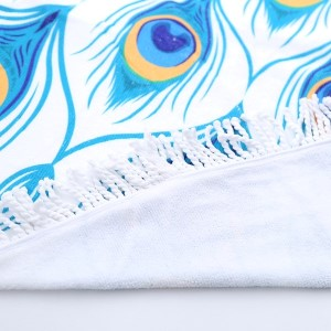 """Peacock feather printed terry cloth roundie beach towel with frayed edges. 100% cotton. Approximately 60"""" in diameter."""