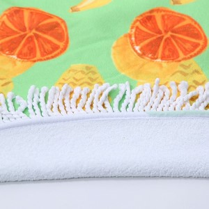 """Assorted fruit printed terry cloth roundie beach towel with frayed edges. 100% cotton. Approximately 60"""" in diameter."""