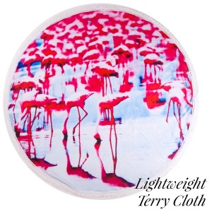 """Lightweight flamingo printed terry cloth roundie beach towel with frayed edges. 100% cotton. Approximately 60"""" in diameter."""