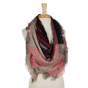 """Beige, red, and black printed, lightweight, blanket scarf with frayed edges. 100% viscose. Measures 56"""" x 56"""" in size."""