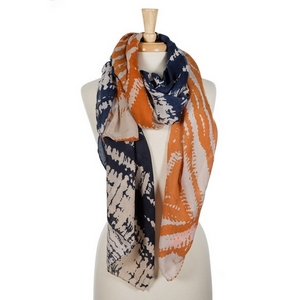 """Navy blue and orange tie-dye printed open scarf. 100% viscose. Measures 36"""" x 72"""" in size."""