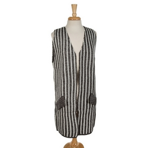 Charcoal and white striped vest with faux pockets. 70% acrylic and 30% wool. One size fits most.