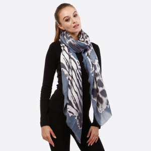 """Navy blue and gray open scarf with animal prints and frayed edges. 100% viscose. Measures 36"""" x 72"""" in size."""
