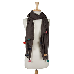 """Lightweight charcoal gray, open scarf with pom poms along the bottom edges. 65% polyester and 35% viscose. Measures 36"""" x 66"""" in size."""