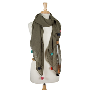 """Lightweight olive green, open scarf with pom poms along the bottom edges. 65% polyester and 35% viscose. Measures 36"""" x 66"""" in size."""