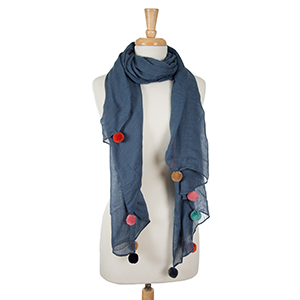 """Lightweight denim colored, open scarf with pom poms along the bottom edges. 65% polyester and 35% viscose. Measures 36"""" x 66"""" in size."""