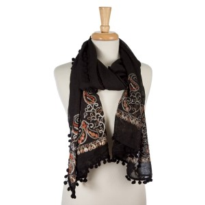 "Black, lightweight scarf with floral embroidery and pom poms on the outer trim. 65% polyester and 35% viscose. Measures 26"" x 70"" in size."