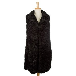 Faux fur, long vest with two pockets, two front buttons and a sherpa look. 100% polyester. One size fits most.