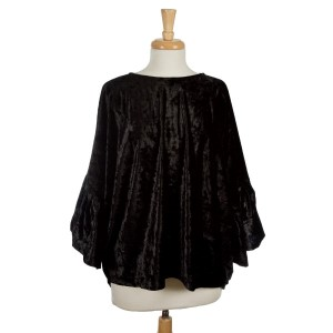 Black, crushed velvet tunic top with an oversized fit and bell sleeves. 95% polyester and 5% spandex. One size fits most.