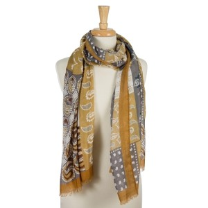 """Mustard, lightweight scarf with a paisley and floral print and frayed edges. 100% viscose. Measures 36"""" x 72"""" in length."""