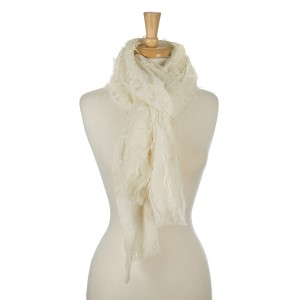 """Heavyweight, knit scarf with a shag pattern and frayed edges. 100% acrylic. Measures 36"""" x 74"""" in size."""