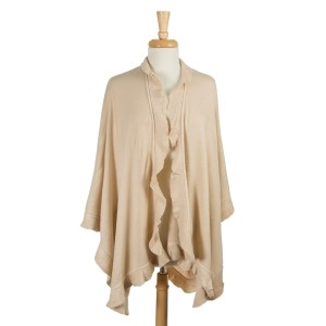 Ivory knit cape with ruffled edges. 100% acrylic. One size fits most.