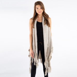Ivory knit vest with a tapered front and fringe along the bottom hem. 100% acrylic. One size fits most.