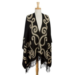 Black and taupe reversible cape with a swirl pattern and tassels along the bottom hem. 100% acrylic. One size fits most.