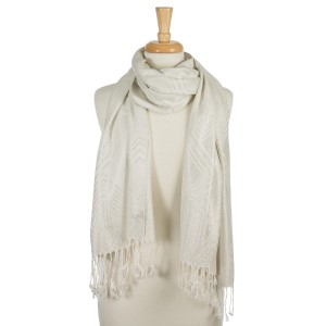 """Ivory lightweight scarf with metallic silver threaded details and tassels on the ends. 55% polyester and 45% viscose. Measures 26"""" x 72"""" in size."""
