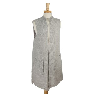 Gray and white knit vest with two front pockets. 100% acrylic. One size fits most.