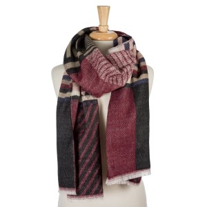 """Black, burgundy, beige and navy blue geometric printed, open scarf with frayed edges. 100% acrylic. Measures 26"""" x 80"""" in size."""