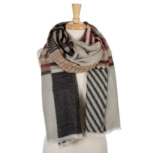 """Gray, black, brown, and burgundy geometric printed, open scarf with frayed edges. 100% acrylic. Measures 26"""" x 80"""" in size."""