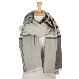 """Gray, black, blue and mauve geometric printed, open scarf with frayed edges. 100% acrylic. Measures 26"""" x 80"""" in size."""