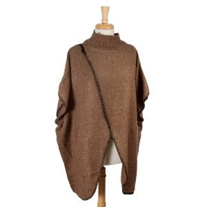 Taupe short sleeve, mock turtleneck sweater poncho with an open front. 100% acrylic. One size fits most.
