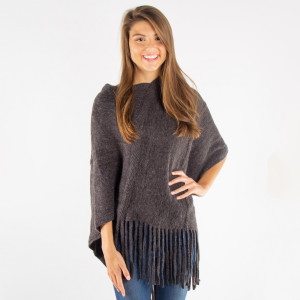 Taupe knit poncho with tassel twist trim. 100% acrylic. One size fits most.